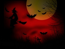 Scary Witch on the Red Halloween Sky